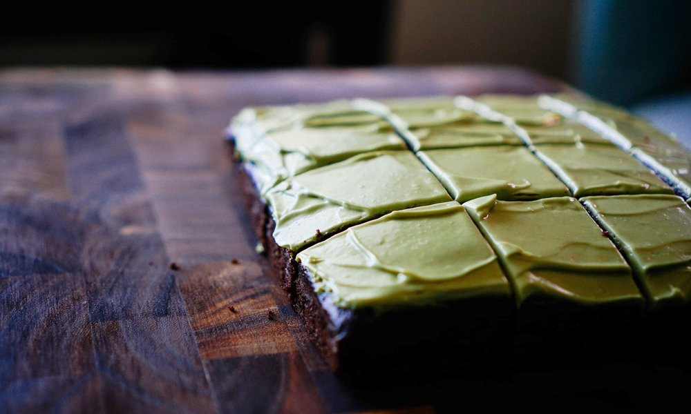 Deeply vibrant green matcha frosting on chocolate zucchini cake